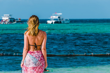 Girl at Bavaro Beaches in Punta Cana, Dominican Republic