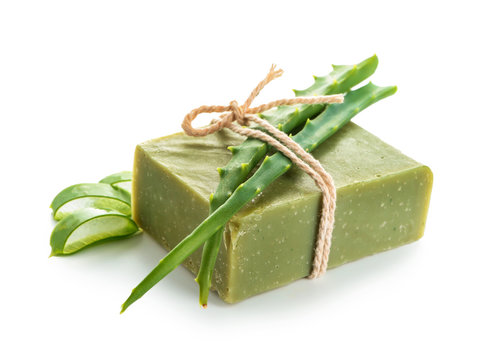 Soap bar with aloe vera on white background