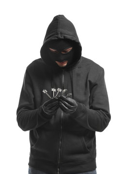 Male thief with keys on white background