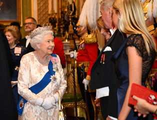 Britain's Queen Elizabeth greets the ambassador of Qatar at an evening reception for members of the Diplomatic Corps at Buckingham Palace in London