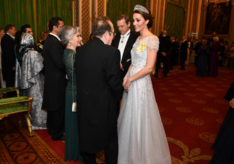 Britain's Catherine, The Duchess of Cambridge, talks to guests at an evening reception for members of the Diplomatic Corps at Buckingham Palace in London
