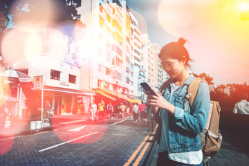 Young woman traveling on Stanley Market in Hong Kong with bokeh light effect