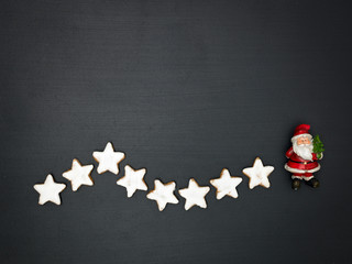 christmas background with different small christmas items on blackboard