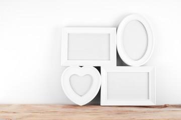 empty, heart shaped photo frame on white background