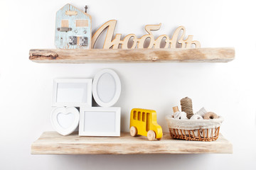 Wooden shelves with decor items. Home interior