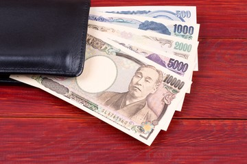 Japanese money in the black wallet