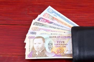 Jamaican money in the black wallet