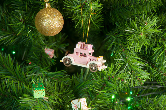 Wooden toy car with gifts on the Christmas tree