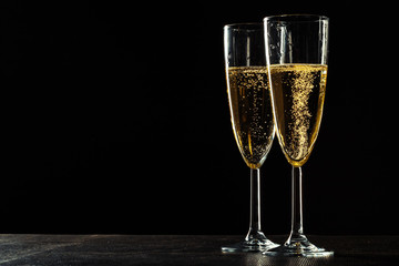 Champagne glasses for festive occasion against a dark background