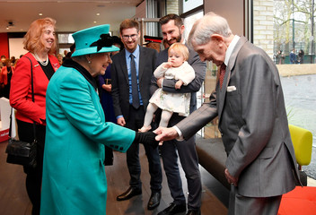 Britain's Queen Elizabeth meets Edward Newton, aged 102, who was a Coram child, during a visit to children's charity Coram in London