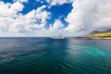 Basseterre, Saint Kitts and Nevis - January 07, 2016: Cruise ships Costa Magica and Celebrity Cruises docked in the port of Basseterre, Saint Kitts Island