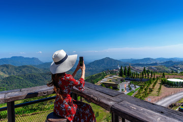 Wall Mural - woman take photo to landscape of khao kho, Thailand.