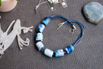 Handmade boho style blue winter beads necklace of polymer clay. Christmas jewelry decor.