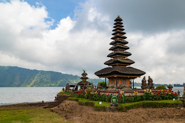 Pura Ulun Danu Beratan in cloudy day, famous temple on the lake, Bedugul, Bali, Indonesia.