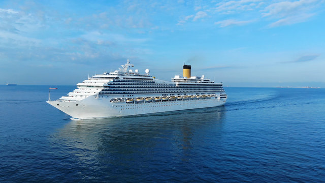 Aerial view of beautiful white cruise ship above luxury cruise concept tourism travel on summer holiday vacation time.