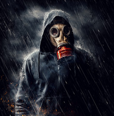 Male in gas mask during the rain