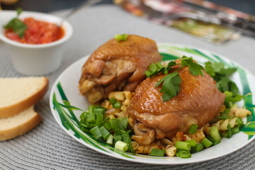 Chicken thighs with spices, soy sauce, green onion and side dish