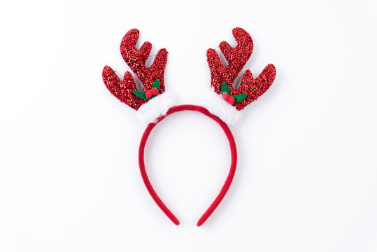 Christmas background concept. Top view of Headband reindeer on white background.