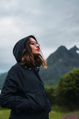 Portrait of a woman wearing hooded jacket, outdoors