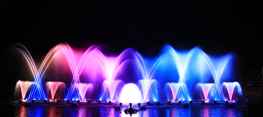 Decoration or show of  colorful of fountain on Father Day at Dokkrai reservoir in Rayong Province Thailand