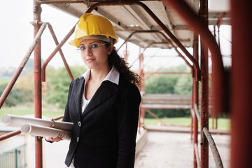 Adult Woman Working As Architect In Construction Site