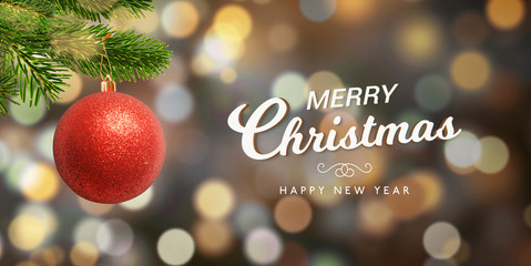 Christmas and New Year geeting card with Christmas tree, decorative red shiny ball and lot of lights, bokeh.