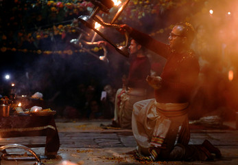 Priests perform religious rituals at Pashupatinath Temple, during the Bala Chaturdashi festival, in Kathmandu