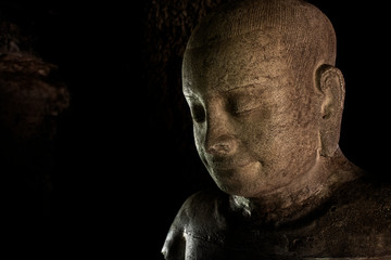 Close up of vintage old  graven image at the historic site in Thailand.