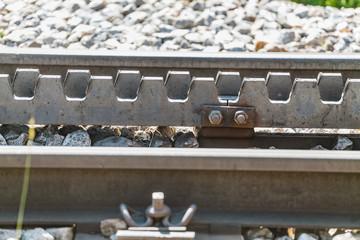 Detail of a cogwheel railway in mountains