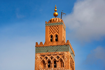 Koutubia mosque largest in Marakech. One of most popular landmarks of Morocco. Ornamented with curved windows, a band of ceramic inlay, pointed merlons, and decorative arches