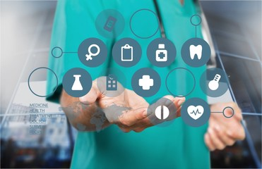 Close-up Doctor with stethoscope and digital icons