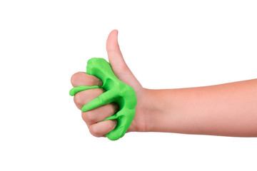 The child crushes the slime in his hand. Slime sandwiched in hand.