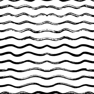 Seamless pattern with hand drawn waves. Hand drawn vector ornament for wrapping paper.