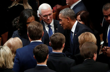 Vice President Pence watches former President Obama greet guests at state funeral for former U.S. President George H.W. Bush at Washington National Cathedral