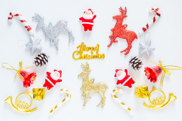 merry christmas and happy new year festive greeting card decoration mock up toys composition top view flat lay on white background.