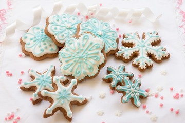 Christmas decoration with cookies in the shape of snowflakes and stars on a white background. Top view.