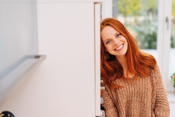 Happy relaxed young redhead woman