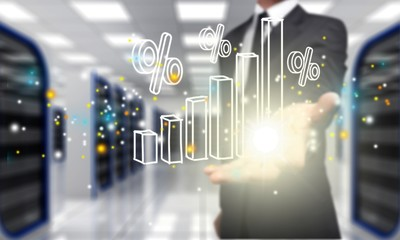Businessman and analytics symbols on blurred background