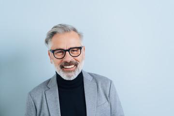 Happy friendly bearded man wearing glasses