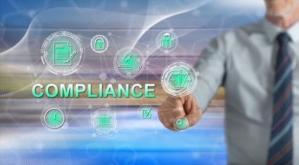 Man touching a compliance concept