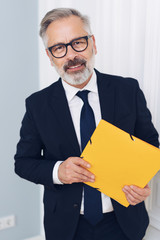 Thoughtful businessman holding a document