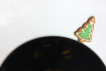 Christmas tree in the form of cookies and vinyl record music with taste for the winter holidays