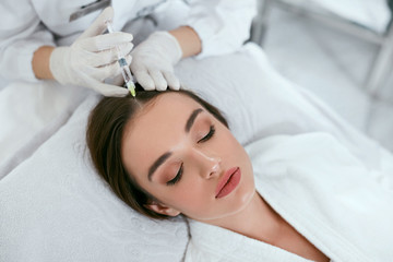 Mesotherapy For Hair Growth. Woman Receiving Injection In Head