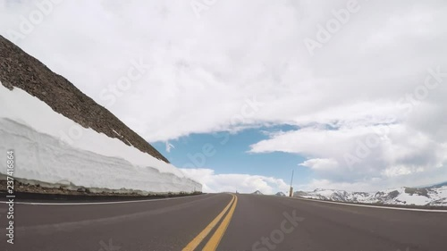 Wall mural Driving on Trail Ridge Road on opening weekend of the season in Rocky Mountain National Park.