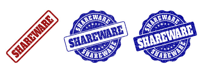 SHAREWARE grunge stamp seals in red and blue colors. Vector SHAREWARE imprints with grunge effect. Graphic elements are rounded rectangles, rosettes, circles and text tags.