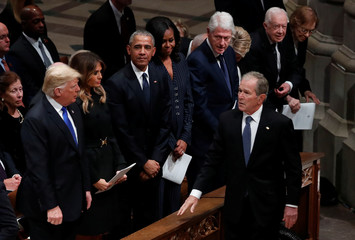 U.S. President George W. Bush walks past former presidents as he arrives at state funeral for his father former U.S. President George H.W. Bush at Washington National Cathedral