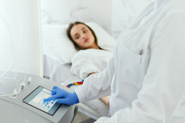 Blood Ozone Therapy. Woman At Blood Transfusion Treatment