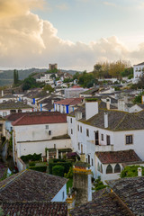 OBIDOS, PORTUGAL - NOVEMBER 20, 2018: View of Obidos at sunset, its streets, squares, walls and its castle are a popular tourist destination
