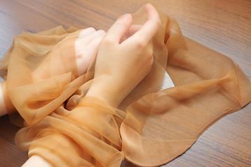Pair of nylon stockings in girl hands