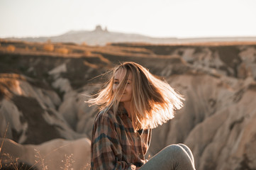 beautiful woman traveler at mountains on sunset. travel, lifestyle, instagram concept